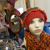 A mannequinn displays a hat and scarf at the Bhayes Designs booth on Saturday at the Christkindlmarket inside the Webb City Farmer's Market.<br /> Globe | Laurie Sisk