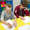 Joplin High School Interact President Tyler Gray helps nine-year-old Parker Smith list what he is thankful for during an arts and crafts project last week at the Boys and Girls Club of Southwest Missouri.<br /> Globe | Laurie Sisk