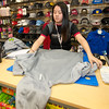 Hibbett Sports Assistant Manager Cindy Young folds an Under Armor hoodie in preparation for Black Friday on Tuesday at the Northpark Mall store.<br /> Globe | Laurie Sisk