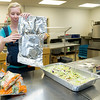 Brooke Fry, operations assistant at the Carthage Crisis Center, helps prepare the Friday evening meal in the same kitchen that will soon begin preparing for about 450 meals for those in need.<br /> Globe | Laurie Sisk