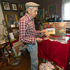 Carthage artist Lowell Davis reflects on his life in the studio inside his home - an old slave cabin at Red Oak II - on Tuesday afternoon.<br /> Globe | Laurie Sisk