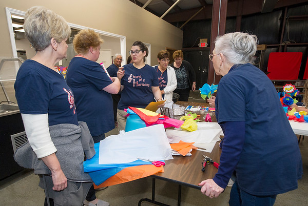 Members of Show-Me Harmony prepare decprations for their after-concert party before rehearsal Thursday night at the Joplin Family Worship Center. The group will perform a  Nov. 12 concert at Ozark Christian College.<br /> Globe | Laurie Sisk