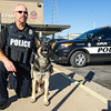 "Joplin Police Officer Randy Black kneels beside his new partner, ""Fighter,"" the department's newest K-9 officer. The two-year-old German Shepard from Poland has logged 400 hours of training with Black and will continue training with his handler for the rest of his career. ""Fighter"" is trained in explosives detection, suspect apprehension and search and tracking.<br /> Globe 