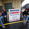 From the left: Brian Spencer,  Jeff Morrow, Tim Belk, Shane Munn and Dan Brand take their places at the front of the line on Wednesday morning for the re-opening of Fred & Red's. Belk, formerly of Joplin, now lives in Austin, Texas.<br /> Globe | Laurie SIsk