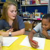 Joplin Joplin High School Interact volunteer Lilly Dorris, left, helps nine-year-old Btaylen Capers list what he is thankful for during an arts and crafts project last week at the Boys and Girls Club of Southwest Missouri.<br /> Globe | Laurie Sisk