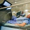 Mercy Clinical Nurse Coordinator Chris Bulita watches diabetes patient Jim Cummings during a demonstration of a hyperbaric treatment on Tuesday at the Mercy Wound Care and Hyperbaric Medicine. Cummings recently received hyperbaric treatment s to heal a diabetes-related wound on his foot.<br /> Globe | Laurie Sisk