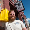 Globe/Roger Nomer<br /> Brent Patterson is carrying a 40-pound water jug for 2 miles to raise awareness for clean drinking water. A benefit for his Drink Local organization is scheduled to take place at JB's.