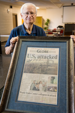Globe/Roger Nomer<br /> Allen Shirley diplays a Joplin Globe reporting on Sept. 11, 2001.