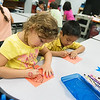 Globe/Roger Nomer<br /> Sophia Kiniry and Athanahi Martinez Martinez  work on an art project during dual-language kindergarten on Wednesday at Fairview Elementary.
