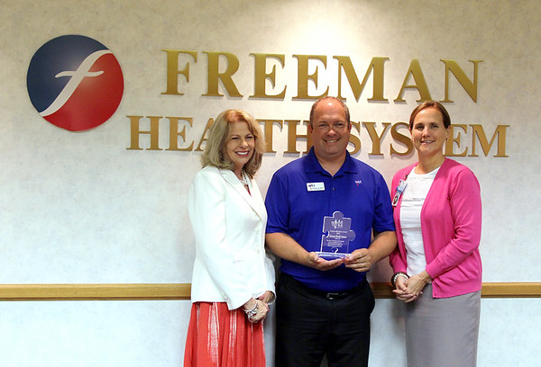 Freeman Contributed Photo<br /> (left to right) Paula F. Baker, Freeman President and Chief Executive Officer; Stephen Gillmore, WTI Career Services Specialist; and Mary Frerer, Chief Human Resource Officer, recognize Freeman Health System as the recipient of the Employer Excellence Award from Wichita Technical Institute Joplin on Thursday at Freeman Hospital West. This is the second year in a row that Freeman has been awarded for its support of WTI Joplin.