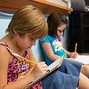 Globe/Roger Nomer<br /> Mackinzie Chenault, left, and Karlan Zaerr, second grade, work on a math exercise on Thursday at Jasper Elementary.