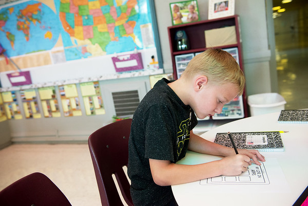 Globe/Roger Nomer<br /> Ansel Sneddon, fifth grade, works on a project in the gifted program on Thursday at the Memorial Education Center.