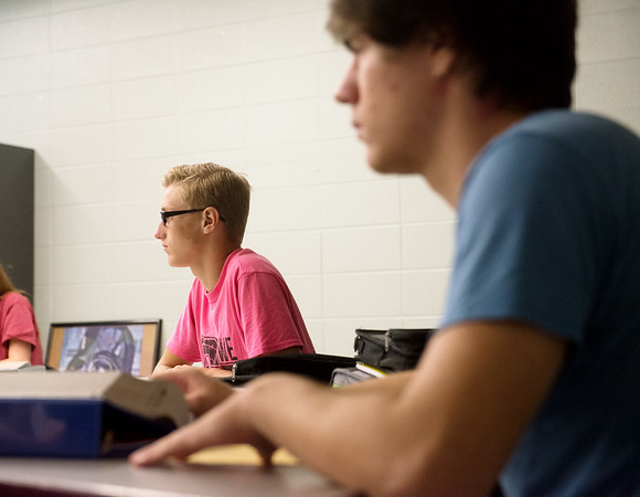 Globe/Roger Nomer<br /> Nathan Vanderpool, left, and Evan Alexander, juniors, take notes during English class on Thursday at Carl Junction.
