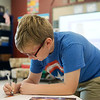 Globe/Roger Nomer<br /> Cameron Souder, third grade, works on a project in the gifted program on Thursday at the Memorial Education Center.