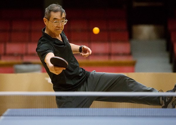 Globe/Roger Nomer<br /> Janus Lazarus makes an off-balance shot while practicing on Monday with the Joplin Table Tennis Club at Memorial Hall.