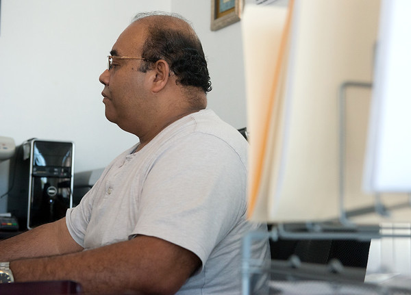 Globe/Roger Nomer<br /> Armando Salgado, owner of A.S. Bookkeeping, works at the Carthage business on Tuesday morning.