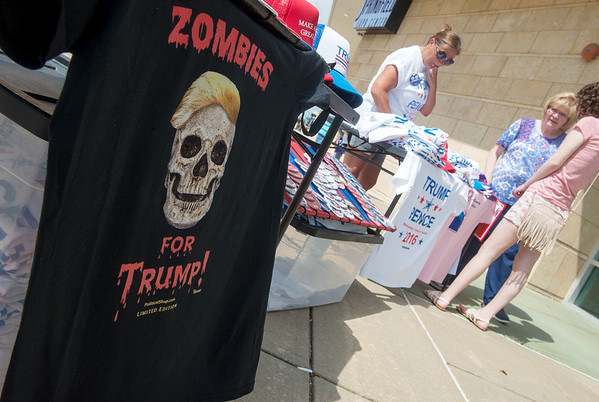 Globe/Roger Nomer<br /> Novelty t-shirts are for sale during an appearance by Republican vice presidential candidate Gov. Mike Pence at the Springfield Exposition Center on Tuesday.