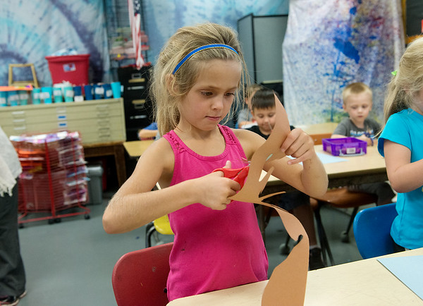 Globe/Roger Nomer<br /> Caley Helms works on an art project in kindergarten on Thursday at Jasper Elementary.
