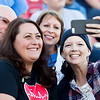 Globe Israel Perez<br /> Amanda Sharp takes a selfie with best friend Diane Southard, father Steve Harris and step mom Debbie Harris on Saturday evening during the CFL All Star game at Carl Junction High School.
