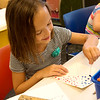 Globe/Roger Nomer<br /> Catherine Martin, 7, decorates a pinwheel in honor of International Dot Day during Creation Station on Thursday at the Spiva Center for the Arts.