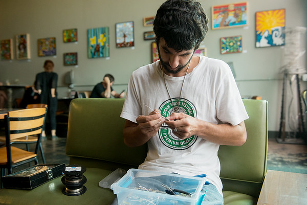 Globe/Roger Nomer<br /> Andy Lewis works on a jewelry piece at One 14 Coffee Bar in Neosho on Sept. 8.