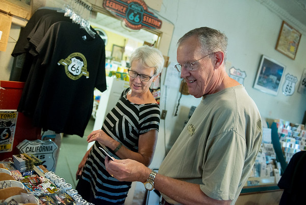 Globe/Roger Nomer<br /> Dick and Marcia Thompson, LaCrosse, Wis., look a magnets at Nelson's Old Riverton Store on Monday.