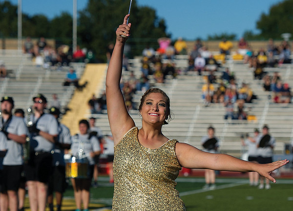 Feature twirler Lauren Dawald performs with the Lion Pride Marching Band prior to the start of Missouri Southern's football game against Missouri Western on Saturday at Fred G. Hughes Stadium.<br /> Globe   Laurie Sisk