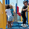 Globe/Roger Nomer<br /> Kaicheng Weng, 4, right, jumps with Makenzie Bernagozzi, 4, left, and Karli New, 4, on Monday at the Family Y Heritage Center in Webb City.