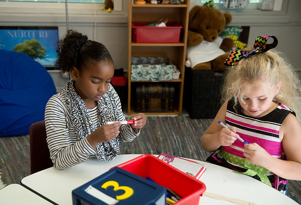 Globe/Roger Nomer<br /> Third graders Dayna Smith, left, and Ilannah Burtrum work on a project in the gifted program on Thursday at the Memorial Education Center.