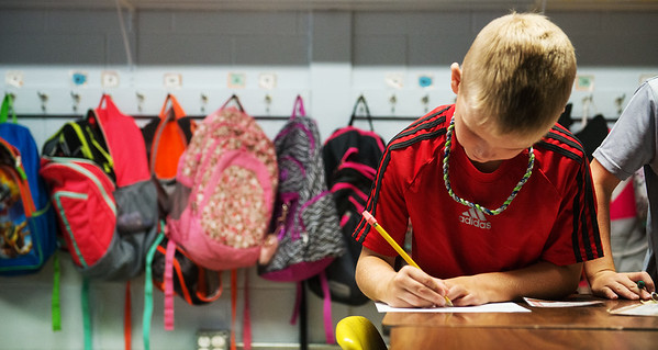 Globe/Roger Nomer<br /> Treyton Ritchhart, third grade, works on a math exercise on Thursday at Jasper Elementary.