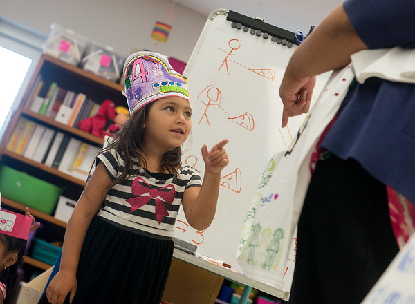 Globe/Roger Nomer<br /> Pricilla Galicia answers a question about colors during dual-language kindergarten class on Wednesday at Fairview Elementary.