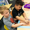 Globe/Roger Nomer<br /> Erick Lira-Menoz, right, traces Kellen Osiier's hand during an art exercise in kindergarten at Jasper Elementary on Thursday.