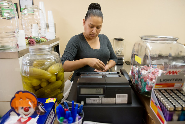 Globe/Roger Nomer<br /> Gicela Deleon prepares for business at El Paraiso on Tuesday in Carthage.