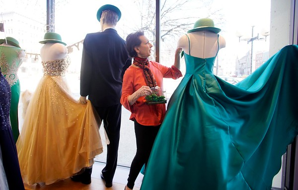 BEN GARVER — THE BERKSHIRE EAGLE<br /> Sharon Martin, manager at Deidre's special Day in Pittsfield, decorates the windows with a St. Patrick's Day theme, Monday, March 11, 2019.