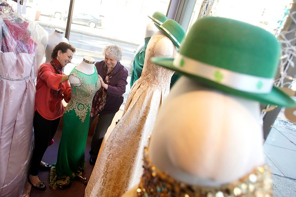 BEN GARVER — THE BERKSHIRE EAGLE<br /> Sharon Martin (far left), manager and Deidre Torra, owner at Deidre's special Day in Pittsfield, decorates the windows with a St. Patrick's Day theme, Monday, March 11, 2019.