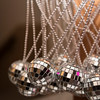 """Disco ball necklaces for attendees of the """"Night Fever!"""" fundraiser at LynnArts on Friday."""