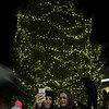Lynnfield, Ma. Crystal Gordon and her mom Paula Gordon take a selfie infront of the Christmas tree at Market Square on Sunday.