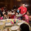 Lynn firefighter Chris Carmody serves the children of Gregg House turkey during their annual Thanksgiving luncheon.