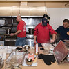 Lynn firefighters, from left, Chris Carmody, Bobby Lehman, Lt. Denis Ring, and Mario Lopez are hard at work cooking a Thanksgiving luncheon for the children of Gregg House.