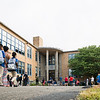 The first students and parents make their way to the entrance of the Julia F. Callahan School as they get ready to start the school year on Wednesday.