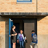A student rushes back out of the Julia F. Callahan School to get something she forgot as another walks in on the first day of school on Wednesday.