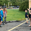 Students pose as parents take the obligatory first day of school photos in front of the Julia F. Callahan School on Wednesday.