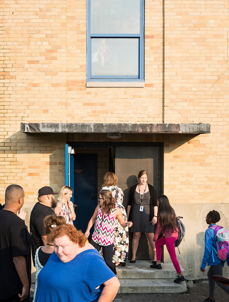 Students begin to file into the Julia F. Callahan School on their first day of classes on Wednesday.