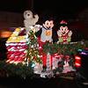 Lynn., Ma. 12-24-17. Jeremy Dunajski as Snoopy, Zach Campbell as Mickey, and Ginny Sanford as Minnie4in this year's Christmas parade.
