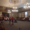 Sept. 16, 2017. Grand Army of the Republic Museum tours, Lynn. Guests mill about the large main hall room on the top floor of the museum, which retains the original furnishings and has walls filled with photos of Civil War veterans.