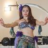 Belly dancer Celia balance a sword on her head at LEO's Greek Night fundraiser at Volunteer Yacht Club in Lynn.