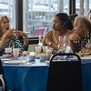 Peter Em, right, and Cristal Hernandez, center, listen to Nancy Nugent during LEO's Greek Night fundraiser at Volunteer Yacht Club in Lynn.