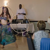 Attendees watch belly dancer Celia during LEO's Greek Night fundraiser at Volunteer Yacht Club in Lynn.