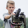 09/16/2017. Military and Veterans Appreciation Day, World Series Park, Saugus. Ashton Horvath handles a machine gun on top of a military vehicle on display.
