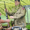 09/16/2017. Military and Veterans Appreciation Day, World Series Park, Saugus. Dave Savoie, a WWII reenactor, shows an event attendee a WWII-era gun.